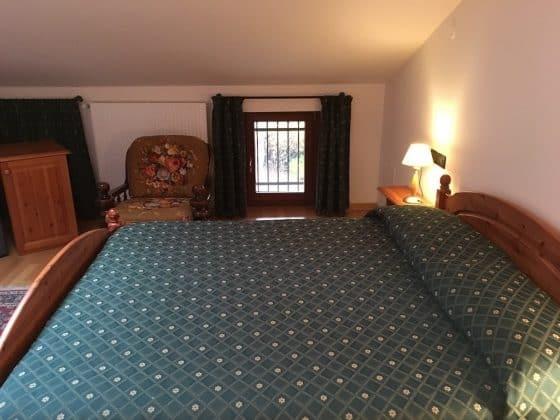 Camera da letto arredata Casa Luis